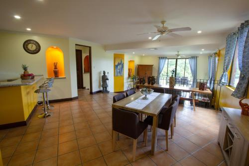 A restaurant or other place to eat at RESERVA CONCHAL Luxury Condo