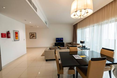 A restaurant or other place to eat at Blue Ocean Holiday Homes - Capital Bay Towers