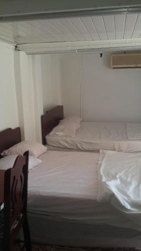 A bed or beds in a room at Julian Guest House
