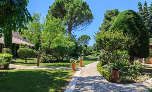 A garden outside Auberge de Cassagne & Spa