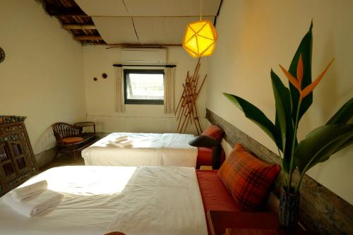A bed or beds in a room at Yellow And Black Guest House