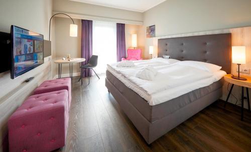 Ein Bett oder Betten in einem Zimmer der Unterkunft Radisson Blu Hotel Bremen