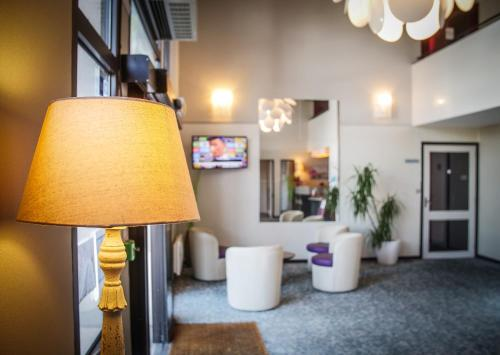 The lobby or reception area at Hôtel Inn Design Resto Novo Alençon