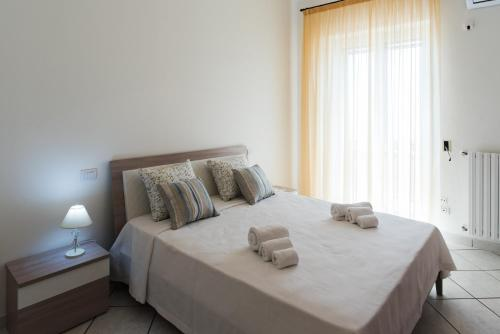 A bed or beds in a room at Dulce Mare
