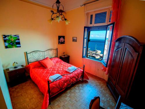 A bed or beds in a room at Barone Bed and Breakfast