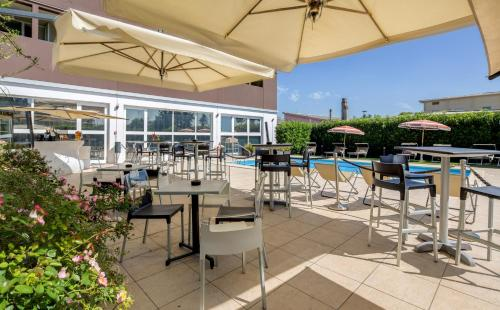 A restaurant or other place to eat at Best Western Plus Hotel Farnese
