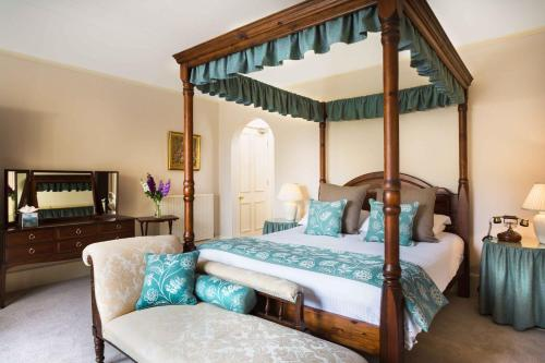 A bed or beds in a room at Penmorvah Manor Hotel