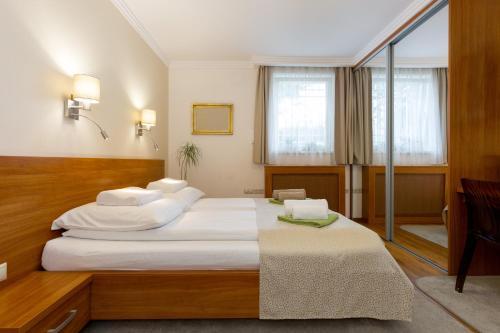 Postel nebo postele na pokoji v ubytování CityPark Villa Flat