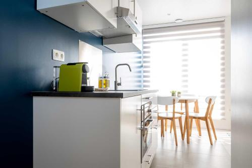 A kitchen or kitchenette at Apartments Brussels Airport