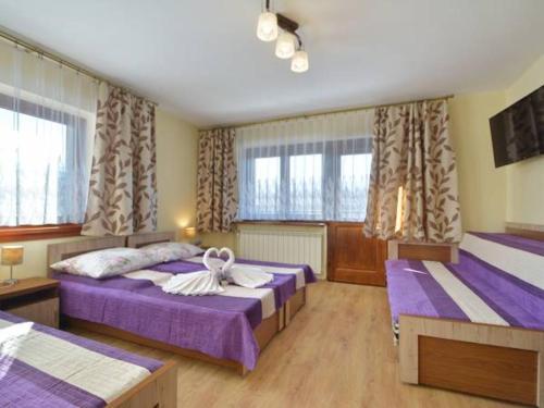 Łóżko lub łóżka w pokoju w obiekcie Pokoje Gościnne Agusia