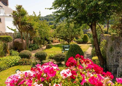 A garden outside Pandora Hotel