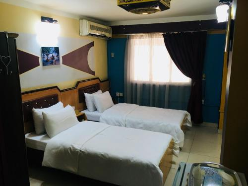 A bed or beds in a room at Dijlat Al Khair Hotel