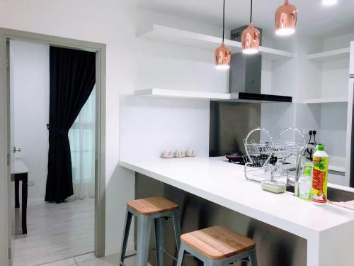 A kitchen or kitchenette at Utopian Homes at Sutera Avenue