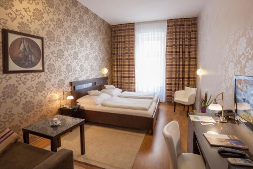 Кровать или кровати в номере Hotel Trinity