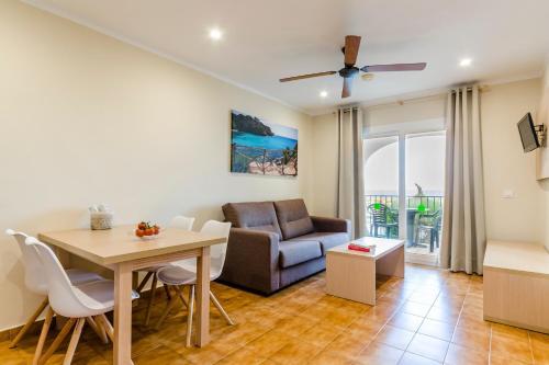 A seating area at Apartamentos Blancala