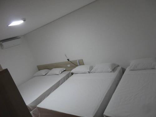 A bed or beds in a room at Hotel Bela Vista Votorantim
