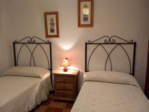 Cama o camas de una habitación en Apartamentos Rurales Mirador de Jubrique