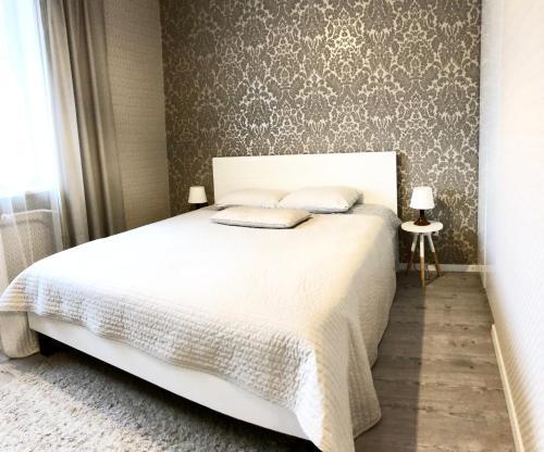 Łóżko lub łóżka w pokoju w obiekcie D&M Apart Sienkiewicza 18