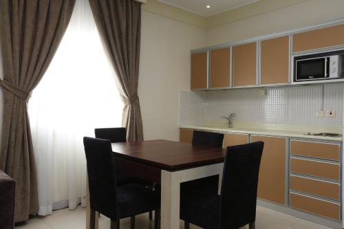 A cozinha ou cozinha compacta de Tobal Al Khobar Furnished Apartments