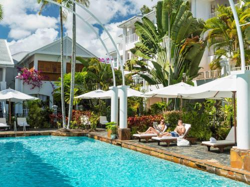 The swimming pool at or near The Reef House - MGallery Hotel Collection