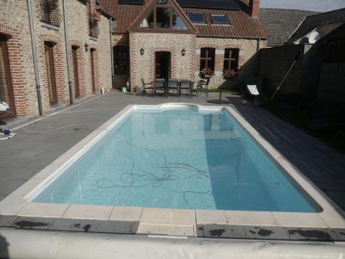 The swimming pool at or near Gite 3 épis Tour de Charme