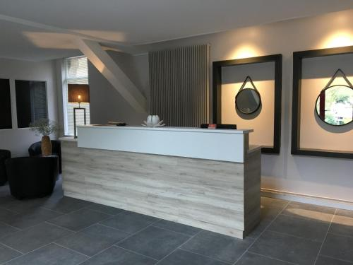 The lobby or reception area at Domaine de Joinville