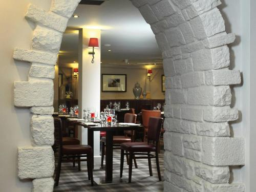 A restaurant or other place to eat at Macdonald Tickled Trout Hotel