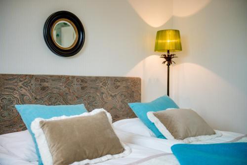Säng eller sängar i ett rum på Trosa Stadshotell & Spa