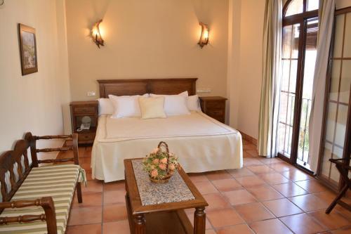 Cama o camas de una habitación en Hotel Sierra de Ubrique