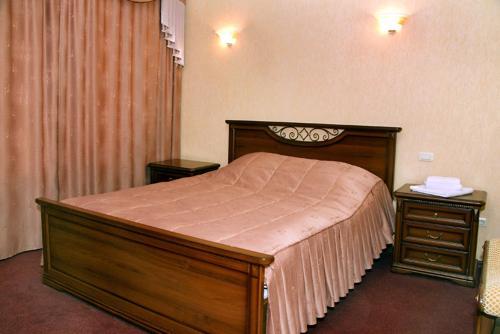 Кровать или кровати в номере Гостиный Дом Визитъ