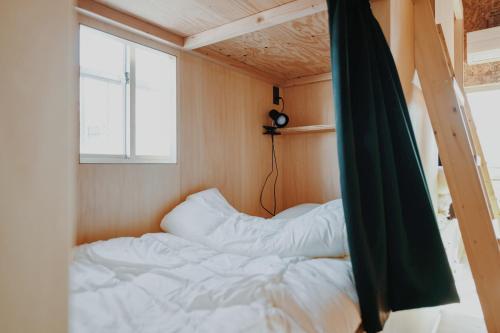 hostelkochi TAOにあるベッド
