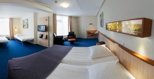 Een bed of bedden in een kamer bij Hotel Princenhof