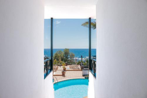 Uitzicht op het zwembad bij El Hotelito Del Golfo of in de buurt