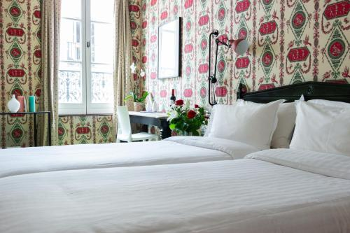 A bed or beds in a room at Prince de Conde