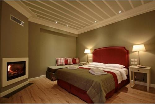 A bed or beds in a room at Nerida Boutique Hotel