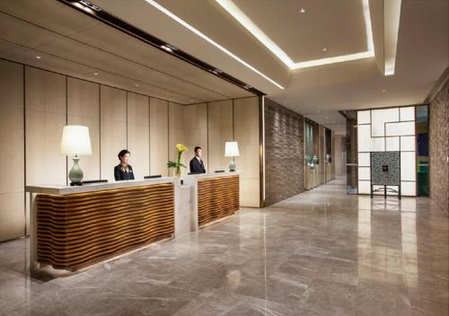 The lobby or reception area at Somerset Wusheng Wuhan