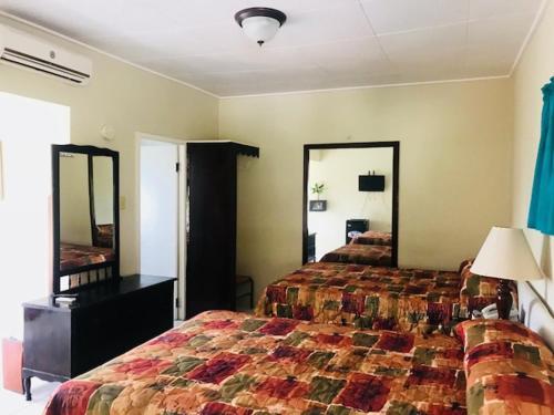 Кровать или кровати в номере Verney House Resort