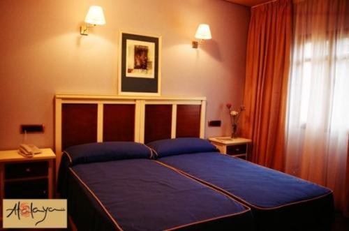 Cama o camas de una habitación en Hostal Atalaya