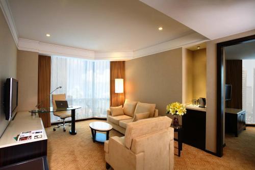 منطقة جلوس في Howard Johnson Huaihai Hotel
