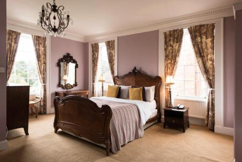 A bed or beds in a room at Dinham Hall