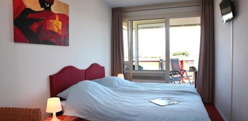 Ein Bett oder Betten in einem Zimmer der Unterkunft Appartementen Amelander Paradijs