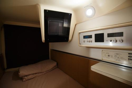 Tempat tidur dalam kamar di The Nell Ueno Okachimachi