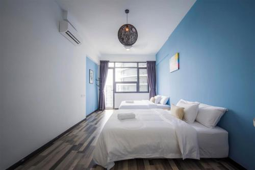 A bed or beds in a room at Arte S Suite 3房式度假公寓套房