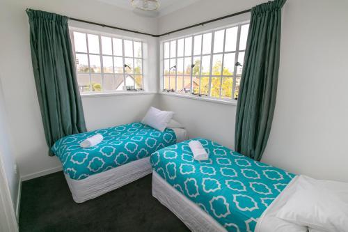 Un ou plusieurs lits dans un hébergement de l'établissement Kiwis Nest Backpackers and Budget Accommodation