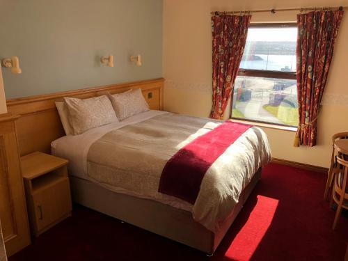 Un ou plusieurs lits dans un hébergement de l'établissement Pier House Bed & Breakfast