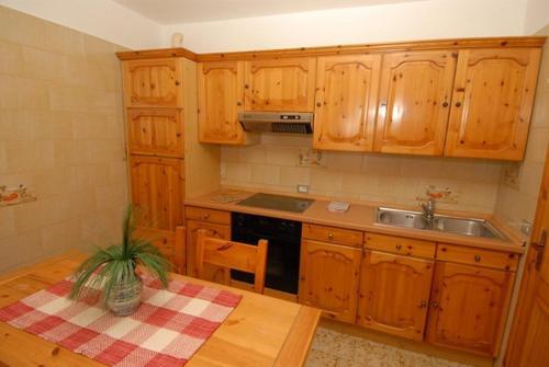 Kuchyň nebo kuchyňský kout v ubytování Baita Guana