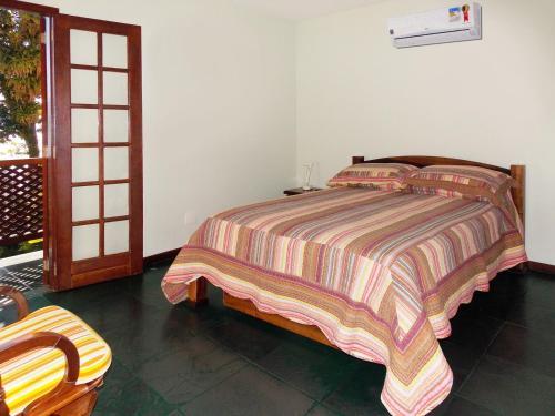 Cama ou camas em um quarto em Pousada Ancoradouro