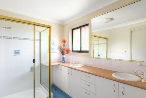 A bathroom at 2/80 Cooloola Drive - Comfortable and cosy unit enjoying ocean views and views to Fraser Island