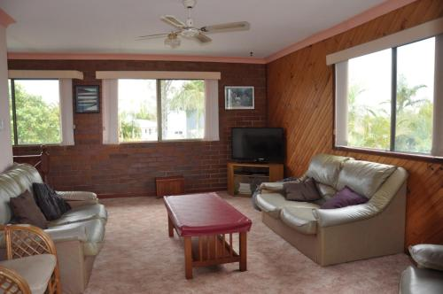 A seating area at 31 Bombala Crescent - Two storey home with covered outdoor deck, fully fenced backyard. Pet friendly