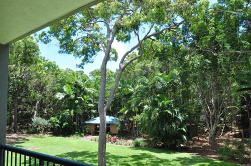 A garden outside 32/15 Rainbow Shores - Unit overlooking bushland with shared swimming pool, spa and tennis court